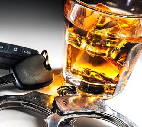 drink driving police hand cuffs