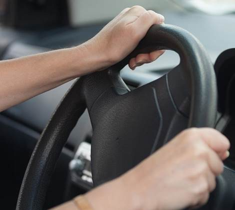 woman driver hands on steering wheel